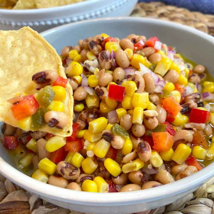 corn and black eyed pea dip with a chip