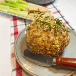 healthy cheeseball appetizer on plate with crackers and celery