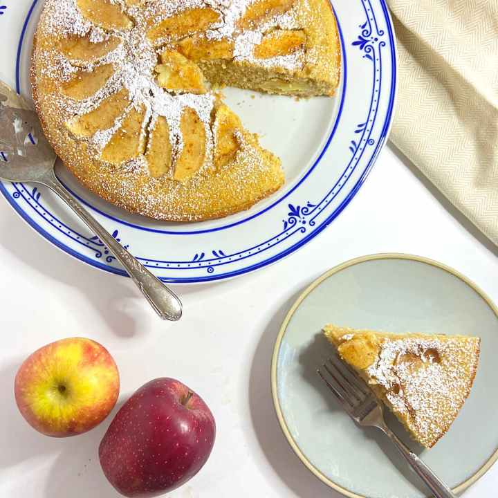 Slice of easy apple cake ready to eat