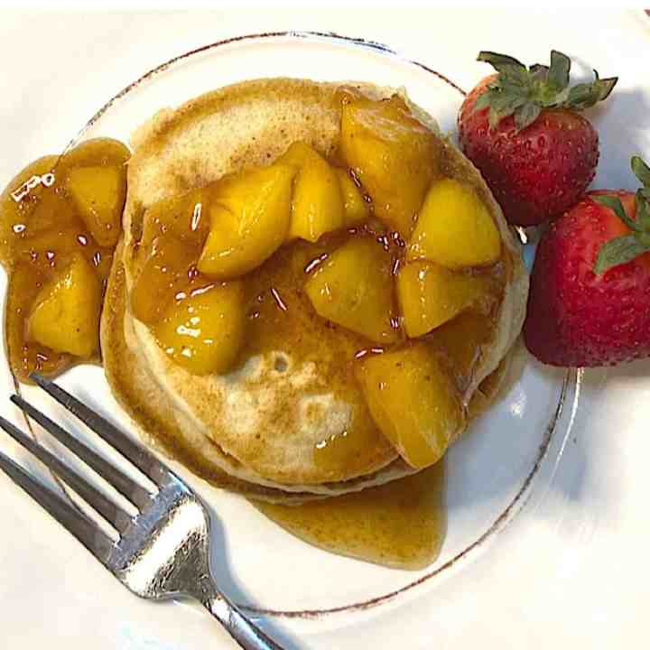 fruit topped healthy pancakes on plate