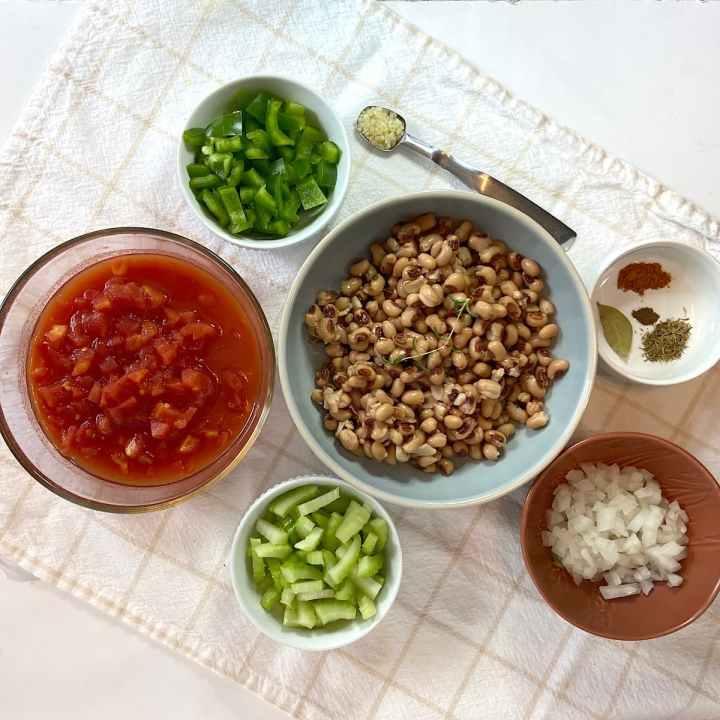 spread of measured black eyed pea ingredients in bowls