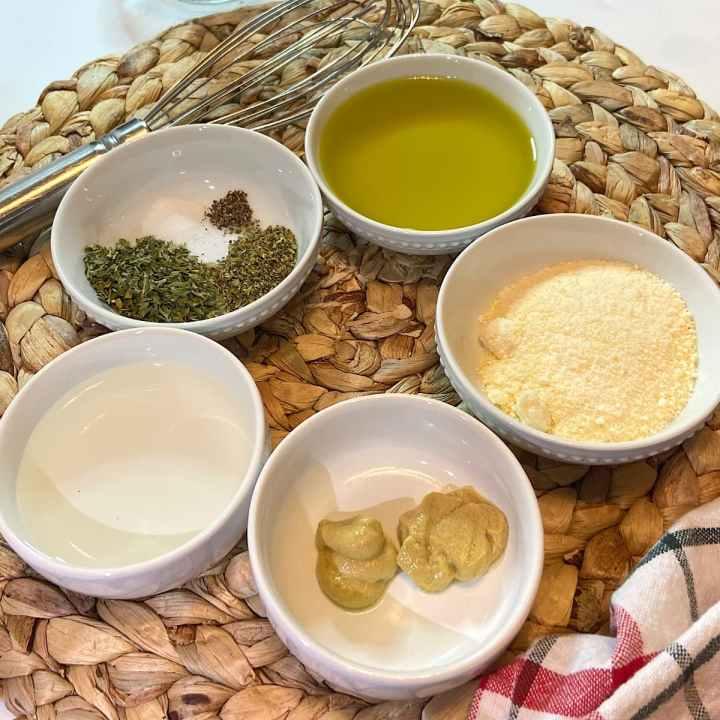 measured ingredients for olive oil salad dressing