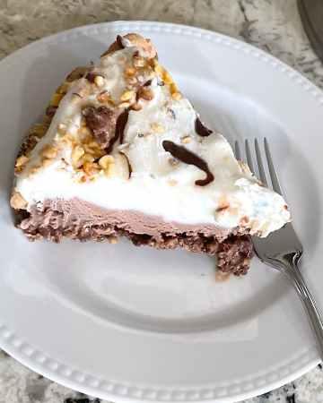 slice of chocolate chip cookie ice cream cake on plate