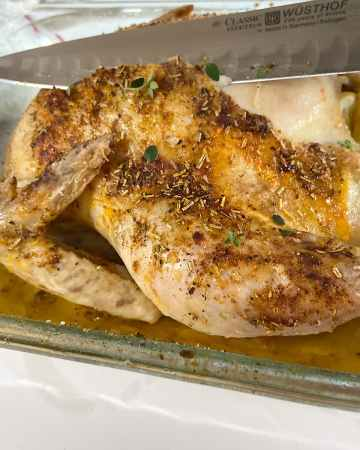 oven roasted chicken in baking dish ready to serve