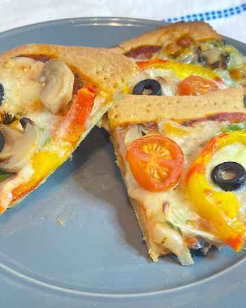 2 slices of thin crust vegetable pizza on a plate