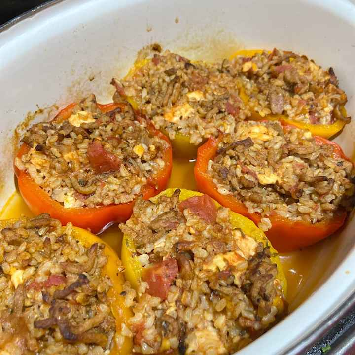 Baked stuffed peppers in pan