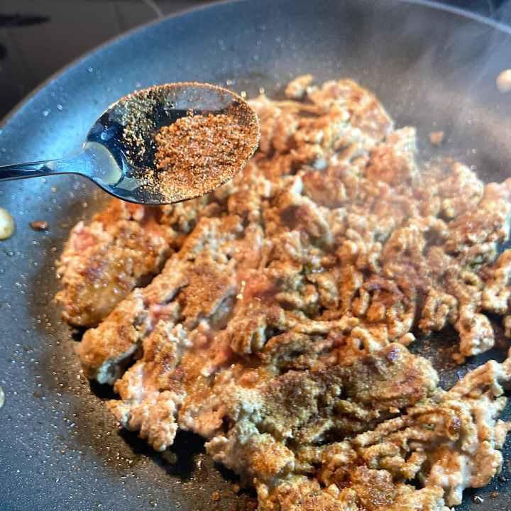 Sprinkle spices over ground turkey