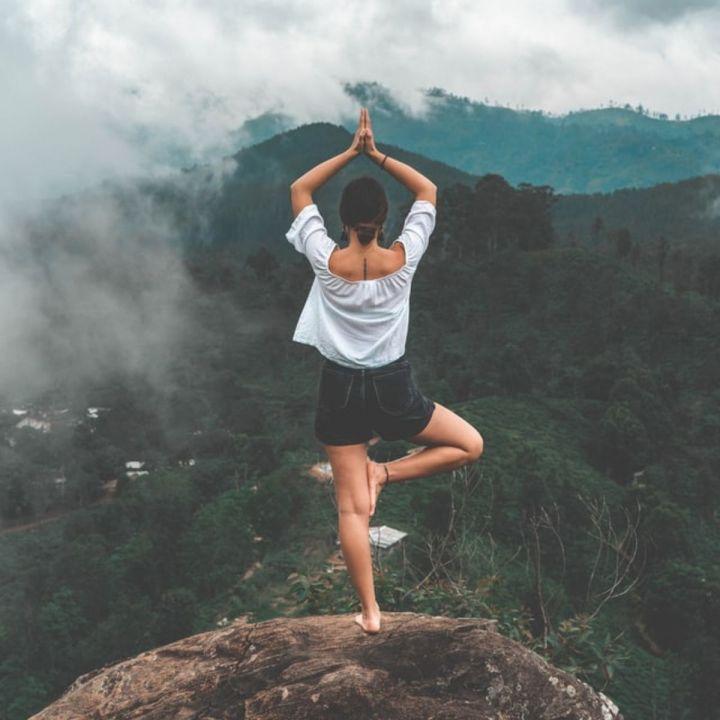 woman with balancing yoga pose