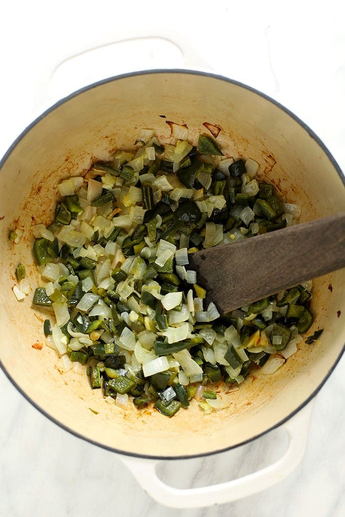 diced green peppers and onions in stockpot