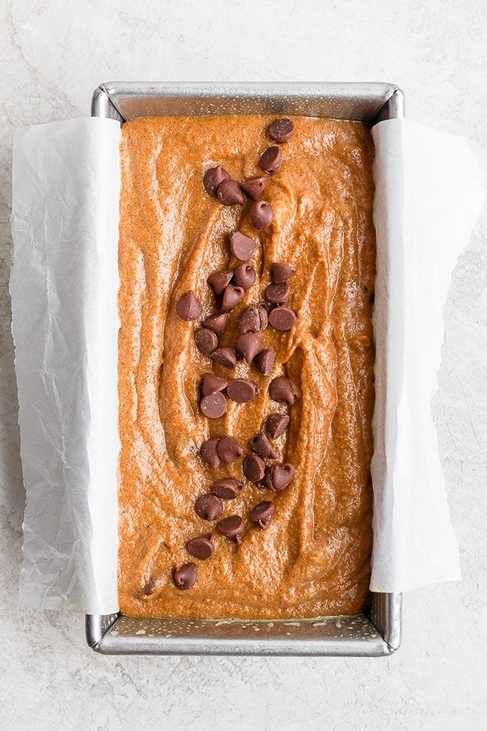 healthy pumpkin bread in a loaf pan ready to be baked