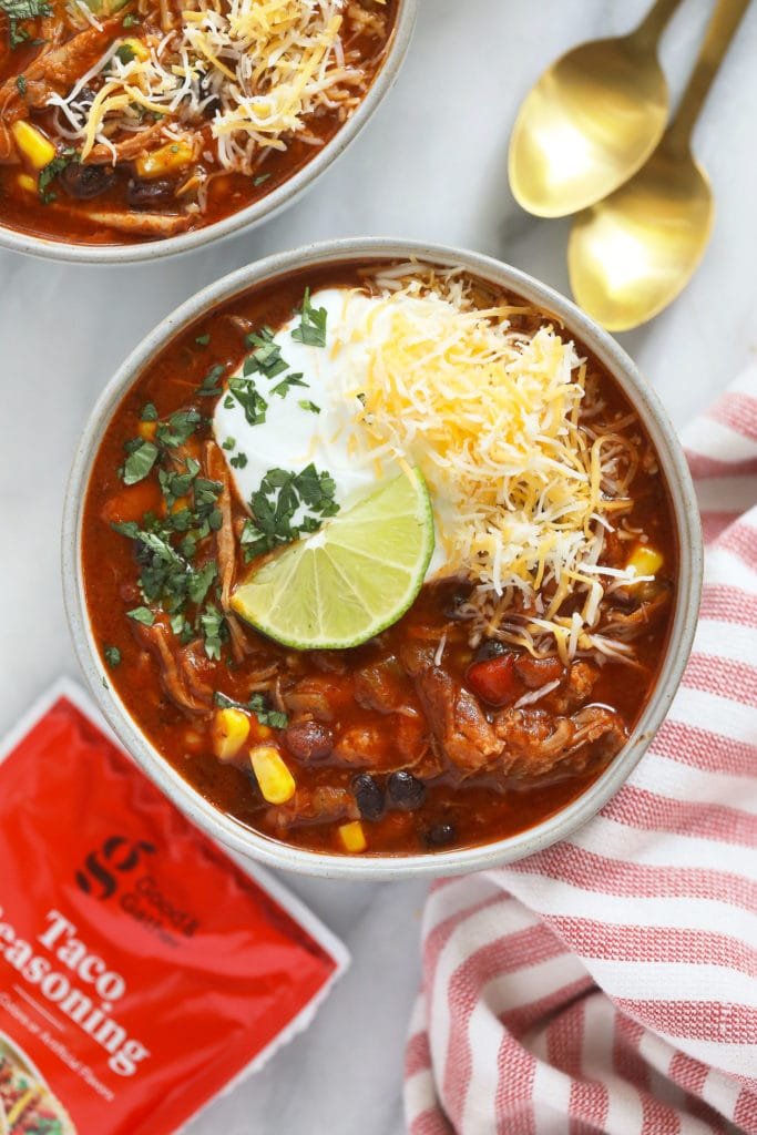 This Instant Pot Pork Chili is about to be your new go-to chili recipe. It's made with 5 basic ingredients including a pork shoulder butt roast, beans, taco seasoning, and a jar of salsa!