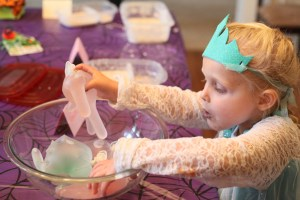 Picture of child playing with a Halloween hand - latex filled with water and glitter glue