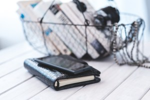 Picture of a fitness journal, phone, and basket