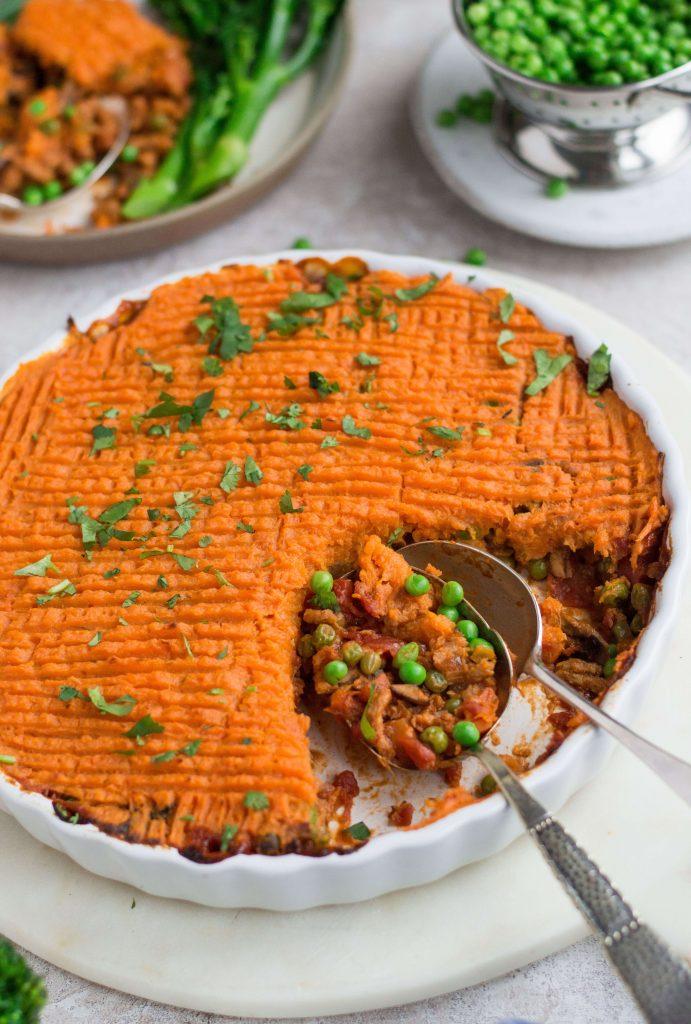 A dish with vegan cottage pie & sweet potato mash