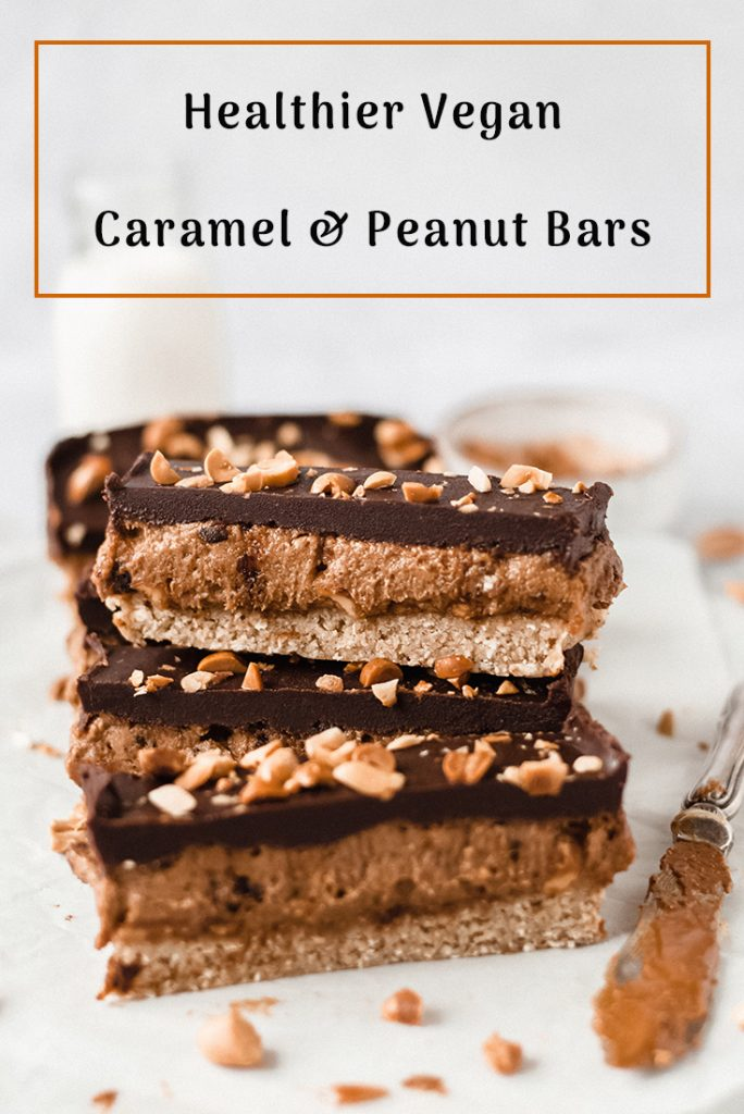 Close up view of vegan peanut and caramel bars with nuts, knife on the side