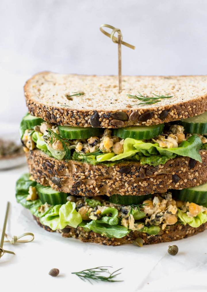 Straight on view of vegan tuna sandwich on a white board - Fit Foodie Nutter