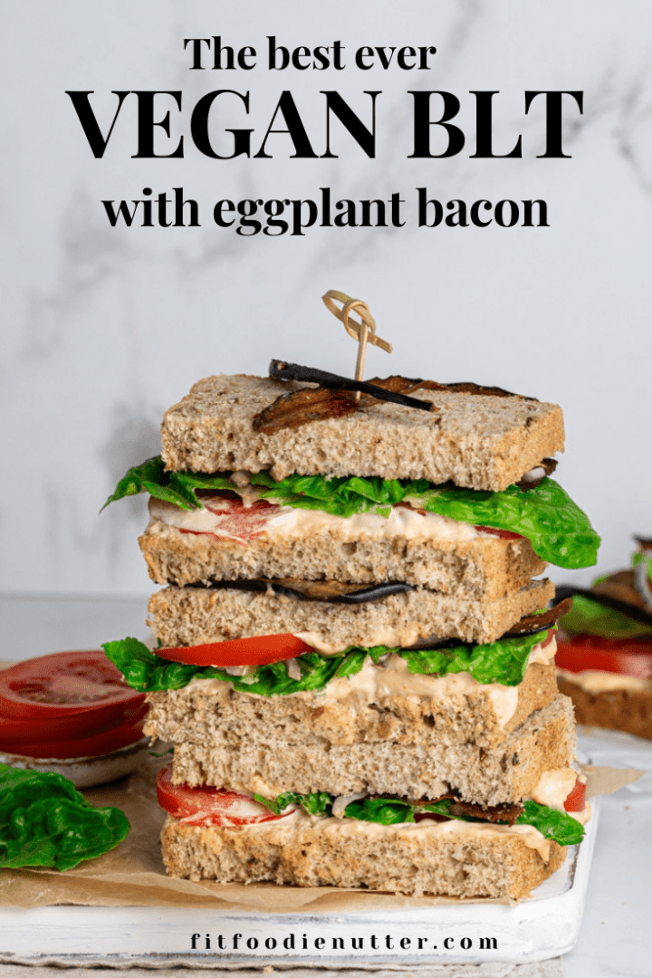 Vegan BLT sandwich with eggplant bacon on a white board