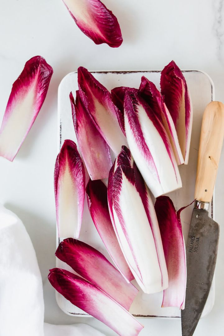 Top down view of red chicory leaves, knife on the side