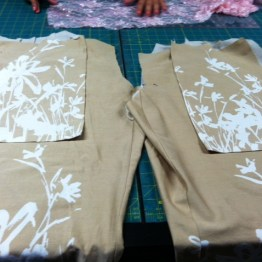 Pant legs with pockets pinned in place.