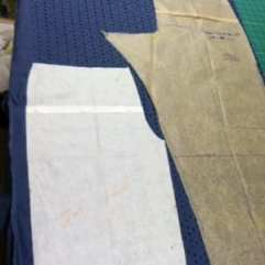 Cutting out the blue eyelet.