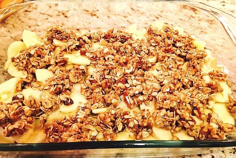 apple crisp in pan to be baked