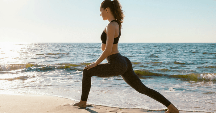 woman on beach doing lunges no equipment needed
