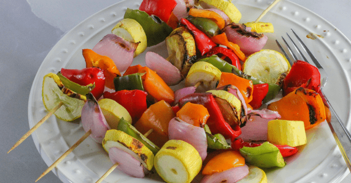 plate of grilled vegetable kabobs ready to eat