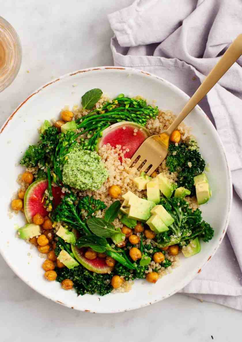 broccoli with pesto quinoa salad in a bowl