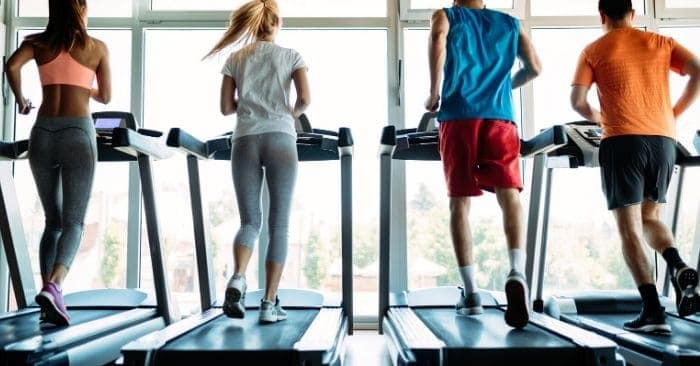 people using treadmills for workout