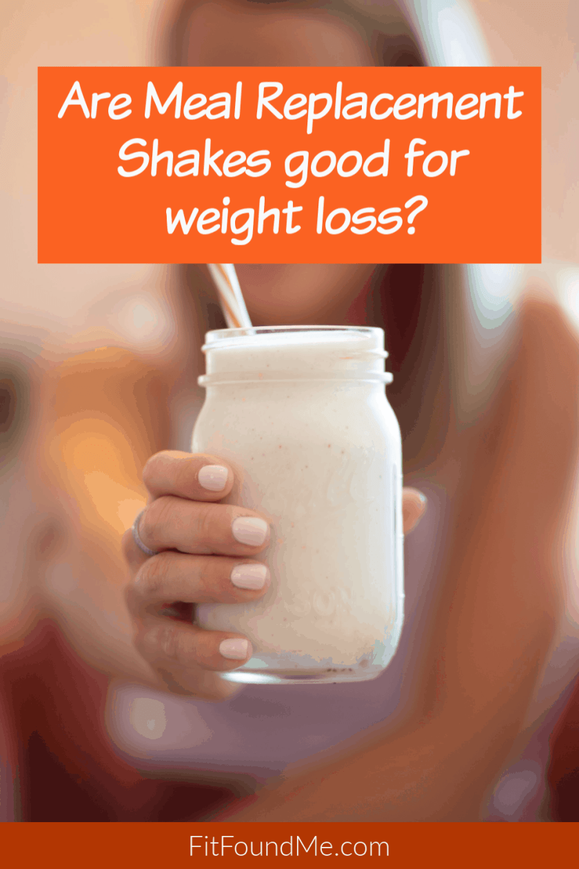 woman holding a shake in a jar