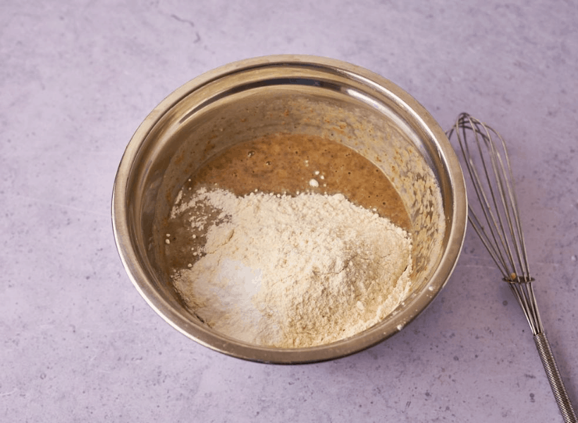 Wet ingredients and flour, salt, baking powder and baking soda added in bowl