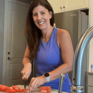 stephanie chopping tomatoes