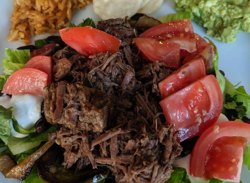 beef barbacoa on salad
