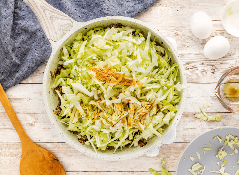 shredded cabbage added to browned ground beef