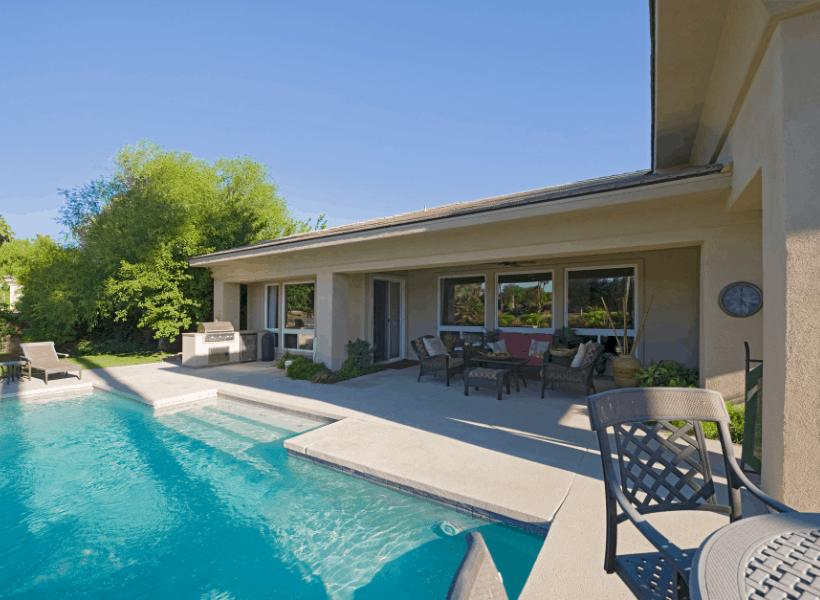 swimming pool behind house