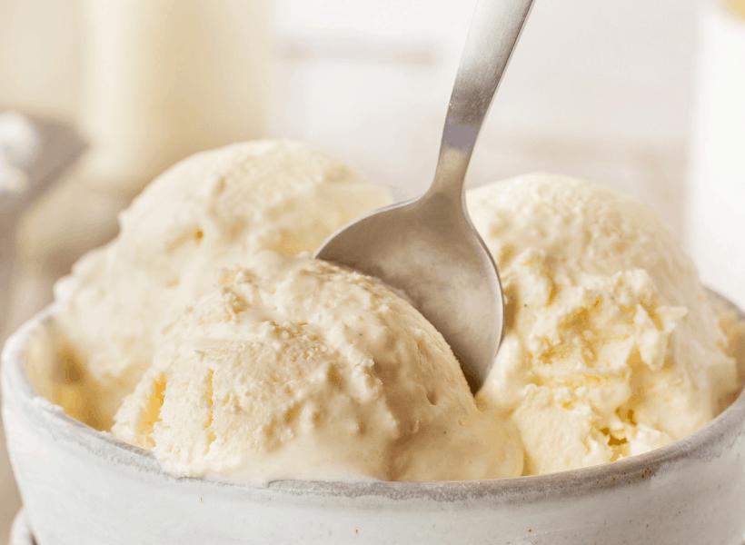 bowl of vanilla ice cream with spoon