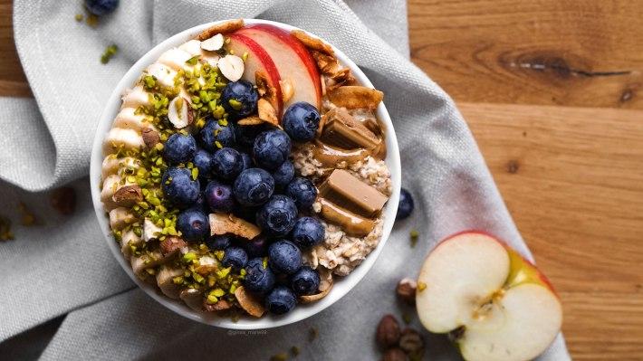 vegan hazelnut oatmeal with chocolate and fruits