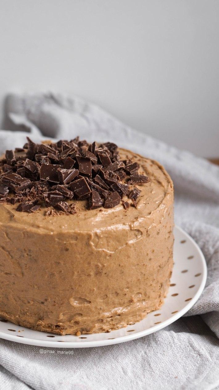Moist and fluffy vegan hazelnut coffee torte topped with espresso chocolate