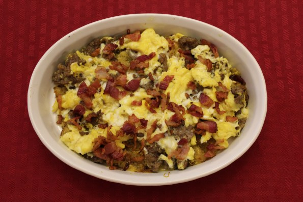 Low-carb Paleo Breakfast Skillet with Spaghetti Squash hash, bacon, sausage and eggs.
