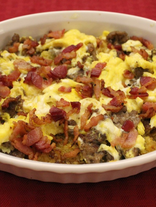 "This Low-carb, Paleo Breakfast Skillet with spaghetti squash ""hash browns,"" sausage and bacon is a delicious, low-carb, protein packed way to start the day!"