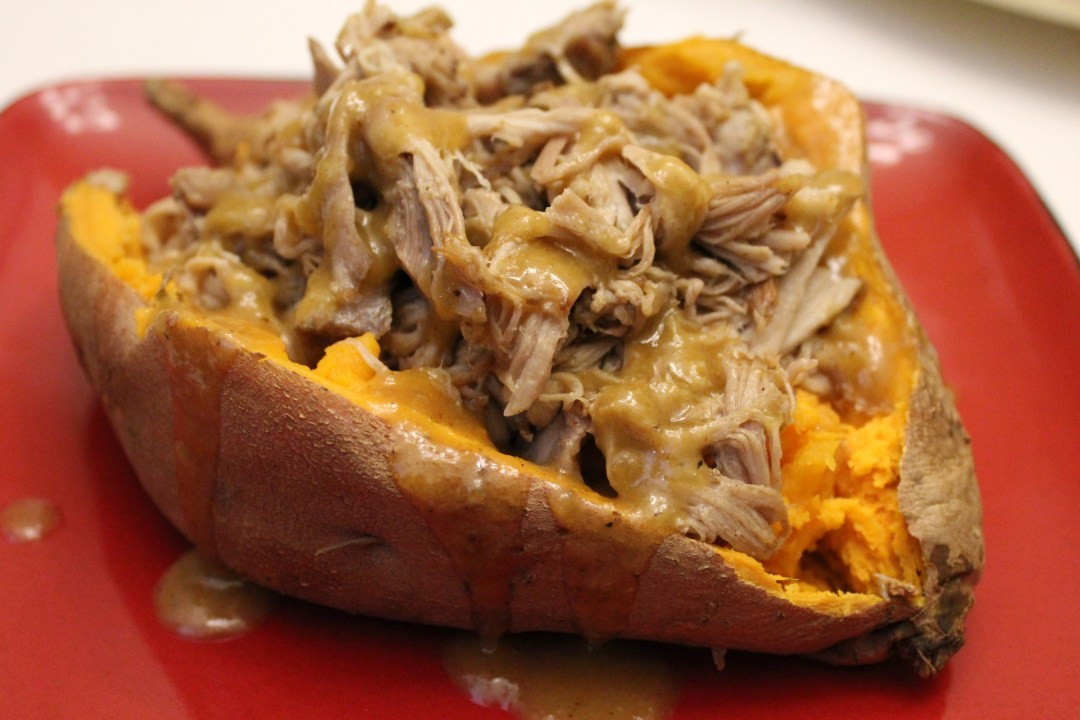 Slow Cooker Pulled Pork Stuffed Sweet Potatoes with Pineapple Honey BBQ Sauce