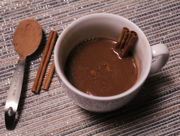 Paleo Spiced Hot Chocolate - made with raw cacao powder and spices such as cinnamon and turmeric, this hot chocolate has multiple healthe benefits!
