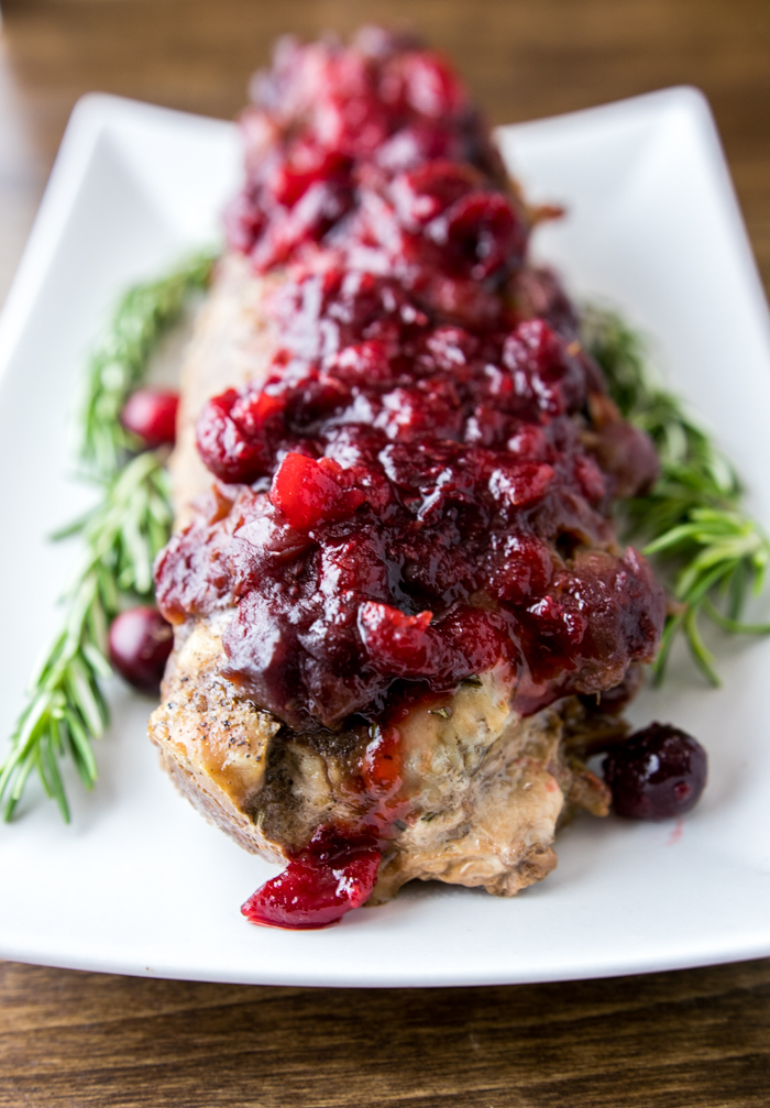 Slow Cooker Cranberry Rosemary Pork Loin on a serving platter