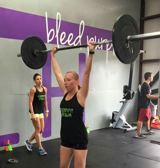 doing a push press in a crossfit gym