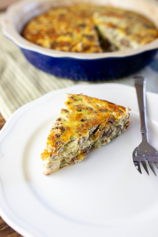 slice of sausage zucchini basil crustless quiche on a plate