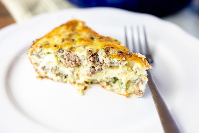 closeup of slice of crustless zucchini bail and sausage quiche