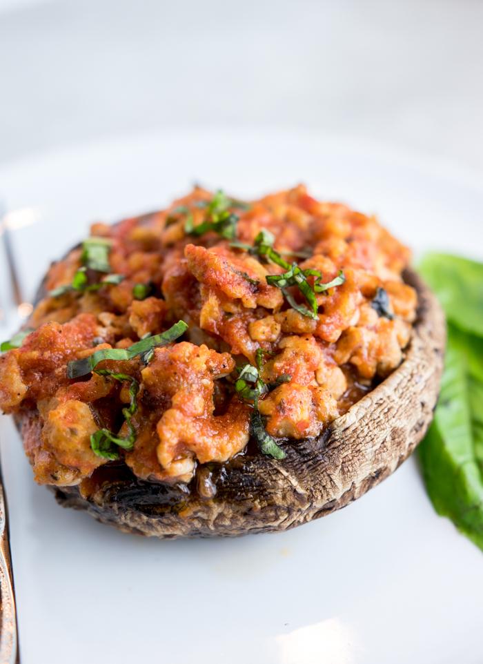 closeup of paleo sausage pizza stuffed portobello mushrooms