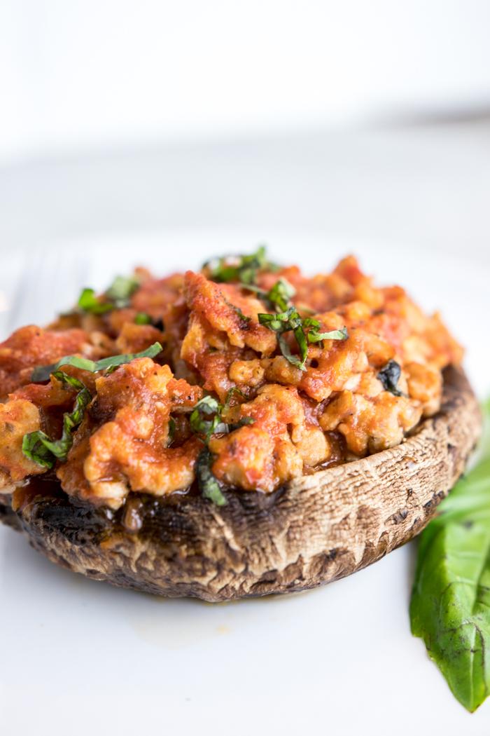 paleo sausage stuffed portobello mushrooms on a plate