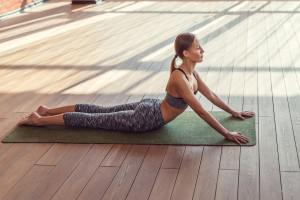 Young girl practicing pilates