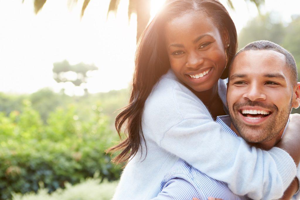 smiling and happy couple practice gratitude